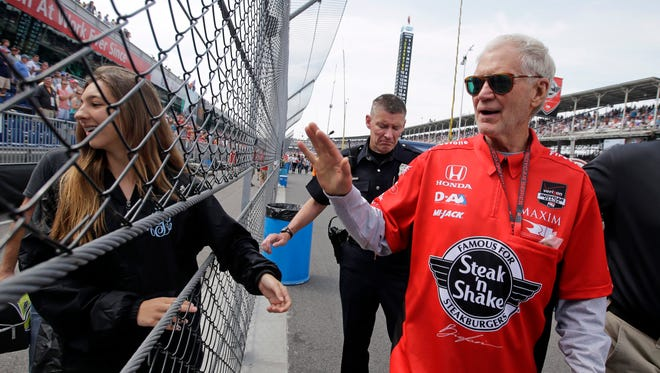 """David Letterman, who ended his 33-year career as a late-night television host in May, waves to fans as he walks through the pit area before the 99th running of the Indianapolis 500 auto race at Indianapolis Motor Speedway. Letterman appeared with comedians Martin Short and Steve Martin at their live comedy show on Friday in San Antonio, where he read """"Interesting facts about Donald Trump."""""""