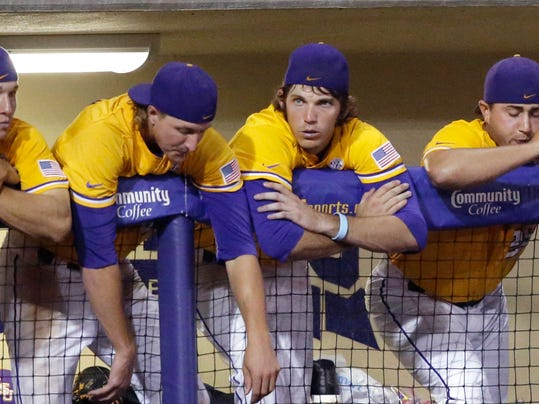 LSU players lean on the dugout during the final two outs of the ninth inning of an NCAA college baseball regional tournament game against Houston in Baton Rouge, La., Monday, June 2, 2014. Houston won 12-2. (AP Photo/Gerald Herbert)