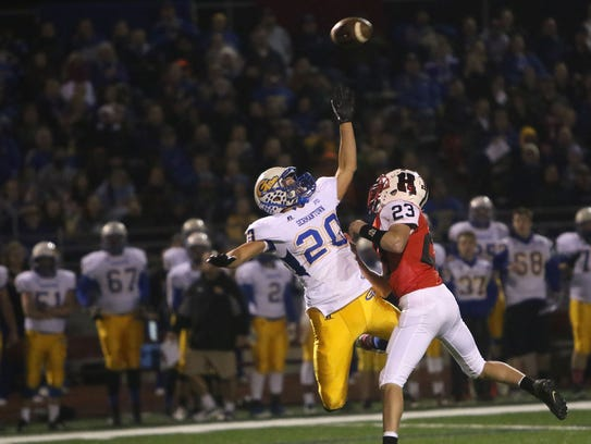 Germantown's Josh Acker (20) reaches up for a pass