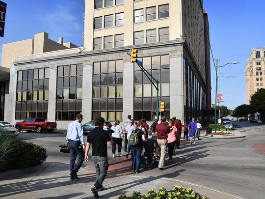 "in this file photo, attendees of a press conference in Park Central  walk across Scott Street to the City National Building where Texoma Community Credit Union announced a branch opening. M.B. Investigations will also call the City National Building ""home."""