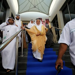 Saudi oil minister Ali al-Naimi, center, attends an energy conference Sunday in Abu Dhabi, UAE.