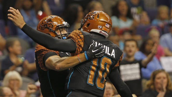 Rattlers' Chase Deadder (81) celebrates with quarterback Nick Davila (10) after a touchdown against the Storm at US Airways Center in Phoenix, AZ on June 6, 2015.