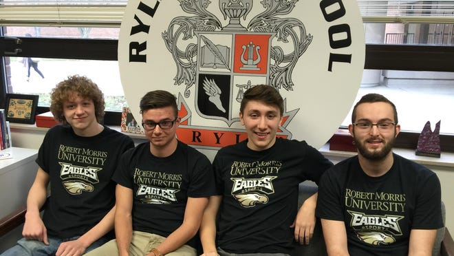 Based on their video game accomplishments, these four Ryle High School seniors were offered full scholarships to Robert Morris University in Chicago. From left are: Henry Kneale, Mason Carnes, Kyle Cousin and Jake Laumann.