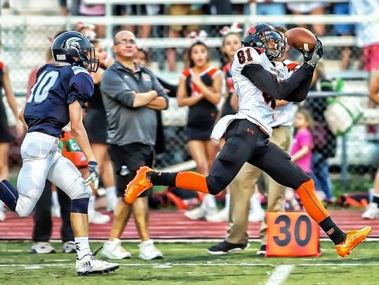Northville's A.J. Abbott (right) gets free for the