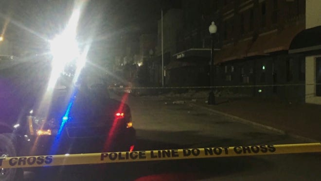 """This image made from video provided by KFOR-TV shows damage on a street in Cushing, Okla., after an earthquake Sunday, Nov. 6, 2016. A sharp earthquake centered near one of the world's key oil hubs Sunday night triggered fears that the magnitude 5.0 temblor might have damaged key infrastructure in addition to causing what police described as """"quite a bit of damage"""" in the Oklahoma prairie town."""