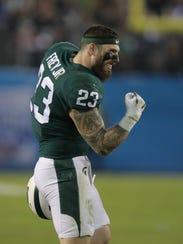 Michigan State linebacker Chris Frey celebrates a touchdown