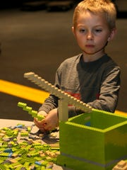 Jackson Bailey, 6, of Ankeny lets his imagination go