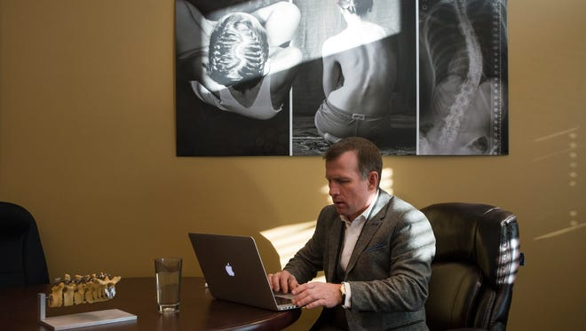 CEO and co-founder of Green Sun Medical Jamie Haggard looks on his computer for examples of his company's prototype back brace for scoliosis patients on Tuesday Dec. 5, 2017, at Innosphere in Fort Collins, Colo.