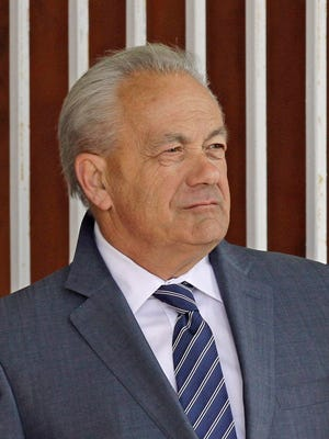 Thoroughbred horse trainer Jerry Hollendorfer in the paddock at Turfway Park race track in Florence, Ky., Saturday, March 22, 2014.