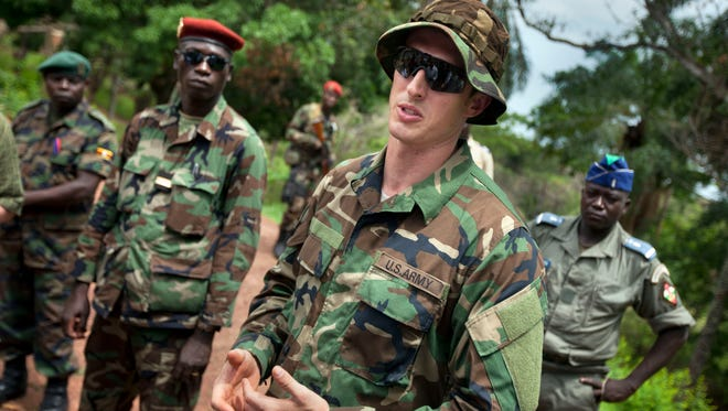 An Army special forces operations officer works in Africa in 2012 with local troops.