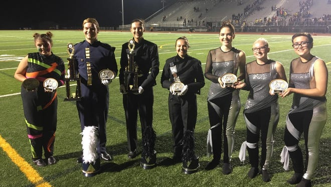Jade Etterman, SLHS Guard Section leader (from left); Chris Holthus, SLHS drum major;   Lauren Hill, SLEHS drum major;  Madelyn Guzick, SLEHS drum major; Anne Liskey, Lilia Condra and Jenna Daykin, SLEHS Color Guard section leaders. Both bands finished first at the Great Lakes Invitational in Plymouth.