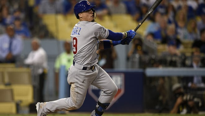 Chicago Cubs second baseman Javier Baez (9) doubles in two runs in the eighth inning against the Los Angeles Dodgers in game five of the 2016 NLCS playoff baseball series against the Los Angeles Dodgers at Dodger Stadium.