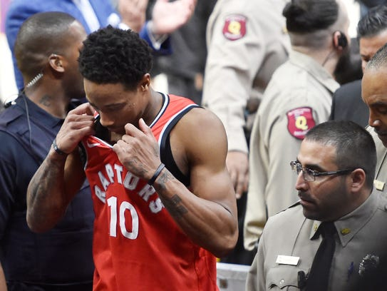 Toronto Raptors guard DeMar DeRozan (10) walks off