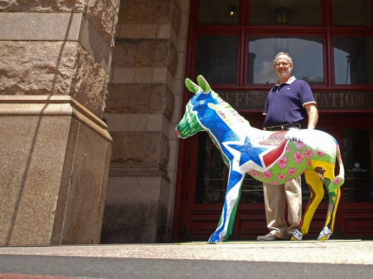 Philadelphia artist Jonathan Mandell is shown with the Delaware donkey sculpture he created for the Democratic National Convention in Philadelphia. The sculpture is located on Market Street under the Pennsylvania Convention Center sign.