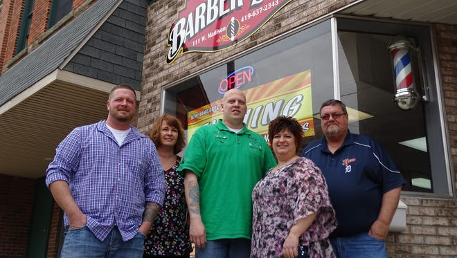 Floriana's Barber Shop and Salon is celebrating its second anniversary. Staff are, from left, owner Derek Floriana, Carla Beard, Nathan Smith, Heather Saxer and Denver Floriana.