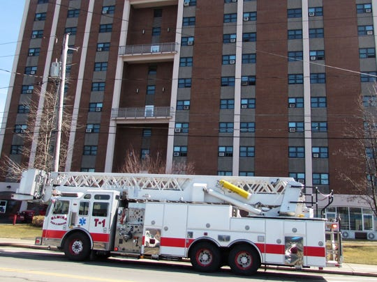 An Elmira fire truck sits outside Bragg Towers senior apartment complex during an emergency call.