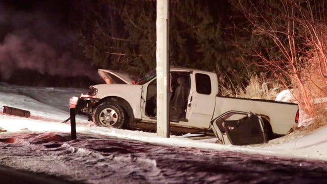 A damaged pickup truck sits in a ditch on Lakeshore road north of Eisner Avenue at the scene of a two car accident Tuesday February 17, 2016 in Sheboygan. An ambulance was at the scene but no further details are currently available.