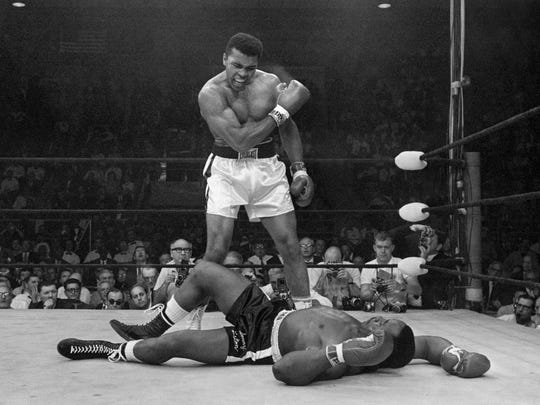 Heavyweight champion Muhammad Ali stands over Sonny