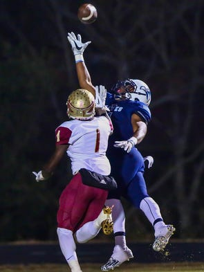 Thomas Clay makes a touchdown catch during a 6A playoff
