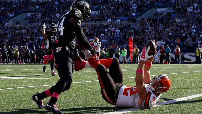Tight end Gary Barnidge #82 of the Cleveland Browns catches a second half touchdown pass in front of defensive back Kyle Arrington #24 of the Baltimore Ravens at M&T Bank Stadium on October 11, 2015 in Baltimore, Maryland.