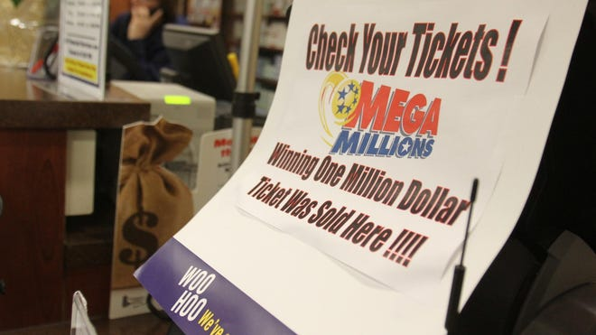 A sign at the ShopRite in the Four Seasons Shopping Center boasts that a $1 million Mega Millions ticket was sold at the store in 2013.