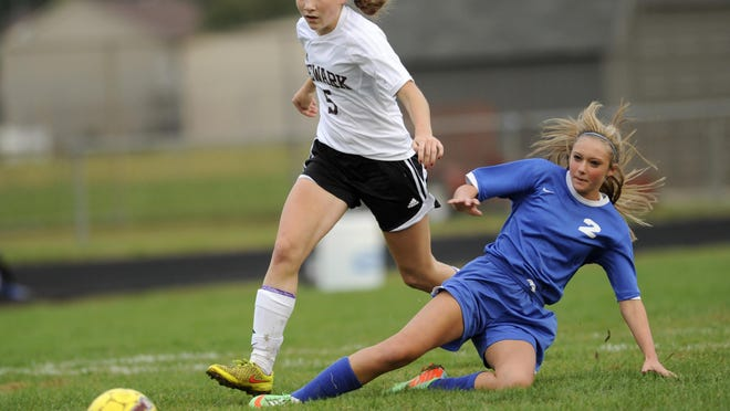 Newark freshman Abby Davies gets around Central Crossing defender Karlee Cammarata last season. Davies had four goals and one assist against the Comets as the Wildcats won their final home game 6-3.
