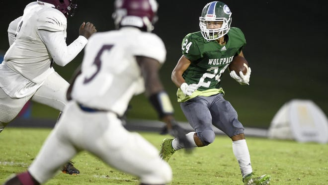 Greenbrier's Kahill Harris tries to elude a pair of Lakeside defenders during football action at Greenbrier High School in Evans, Ga., Friday evening Sept. 18, 2020