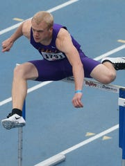Northern Iowa sophomore Jon Rus clears a hurdle in the shuttle hurdle relay at the Drake Relays on Saturday.