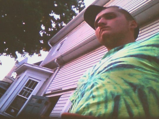 This screenshot from a video that a paid informant captured of a drug transaction shows the man who gave his name as Aaron Roberts.