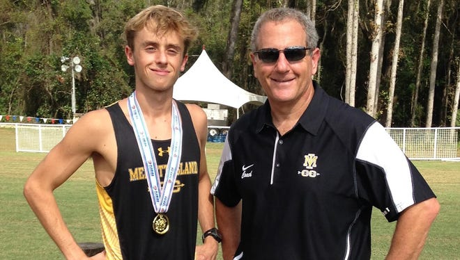 Merritt Island High's Steven Cross shows off his state championship medal with his coach, Bill Bounanni. FOR FLORIDA TODAY
