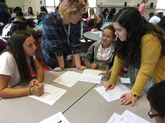Pineville High School freshmen write goals and letters to themselves.
