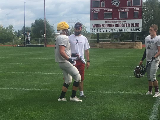 New Winneconne head coach Nate Ryf talks to a player