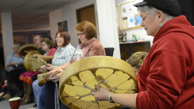 Lori Sandall participates in a community drum circle on Sunday, Feb. 15, at Sacred Space Spiritual Center in Salem.