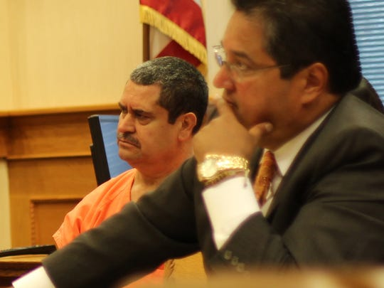 Ruben Gonzalez, left, was sentenced to life in prison after pleading guilty to murder. At his side is his attorney, Esteban Callejas.
