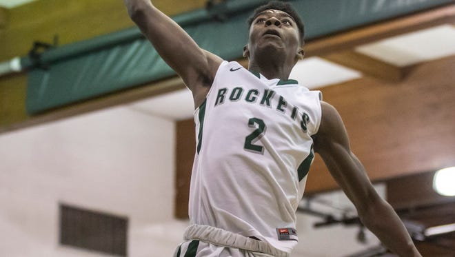 New Haven senior Eric Williams Jr. dunks the ball during a basketball game Thursday, Dec. 29, 2016 at New Haven High School.
