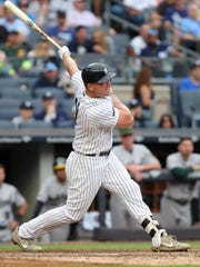 Yankees designated hitter Matt Holliday (17) follows through on a two run home run against the Oakland Athletics during the sixth inning at Yankee Stadium on May 27, 2017.