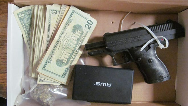 Seized was 13 grams of marijuana, items of drug paraphernalia used for packaging and distribution of illegal drugs, a High Point semi-automatic 9 mm handgun with ammunition and $164 dollars believed to be proceeds from illegal drug sales.