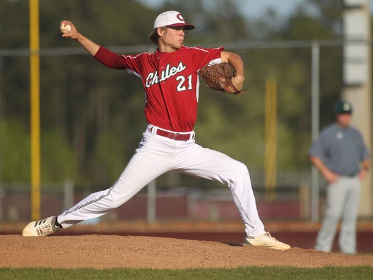 Chiles senior Zach Morea pitches against Lincoln.