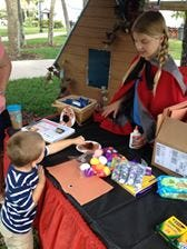 Annie Kaiser, aka Little Red Riding Hood, helps children make wolf masks during the 2016 Storybook Forest.