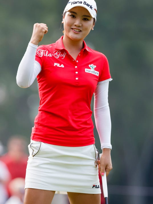 So Yeon Ryu, of South Korea, celebrates after sinking a birdie putt on the 17th hole during the final round of the Marathon Classic LPGA golf tournament at Highland Meadows Golf Club in Sylvania, Ohio, Sunday, July 20, 2014. (AP Photo/Rick Osentoski)