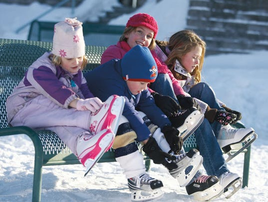 636441022442461504-Children-Tying-Ice-Skates-Courtesy-of-the-American-Club.jpg