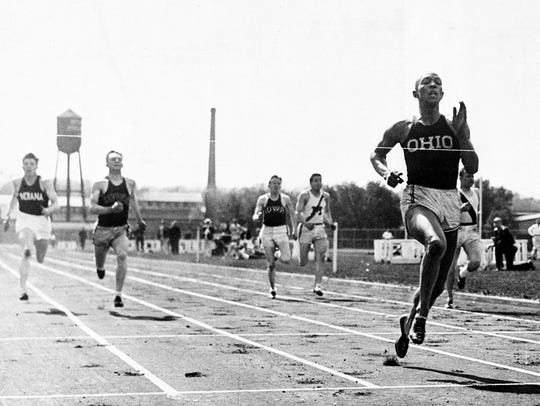 Jesse Owens crosses the finish line in the 220-yard