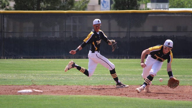 Alamogordo Tiger second baseman Even Best fields a ball while shortstop Rooster Williams backs up Best during the Tiger's 4-3 loss to the Valencia Jaguars Saturday.