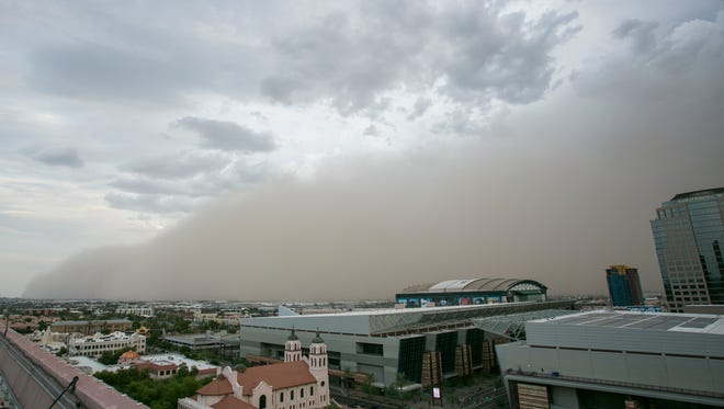 A dust storm approaches downtown Phoenix on Aug. 2, 2018.