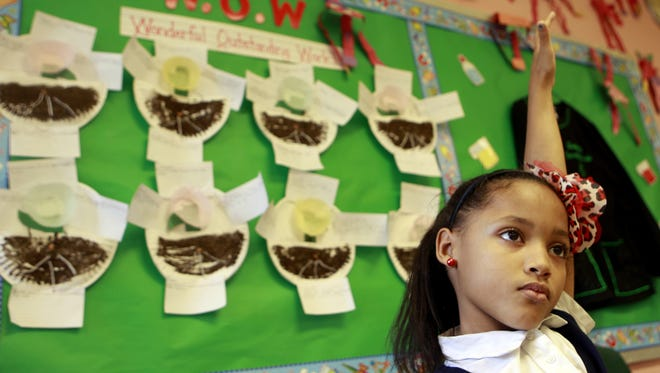 Jazmine Mayes waits to answer a question on different habitats in Roberta Smiley's third-grade classroom at Hamilton County Math & Science Academy, a K-8 charter school in Colerain Township, in October 2012. Greg Harris writes to insist parents and students benefit from more school options, regardless of type.