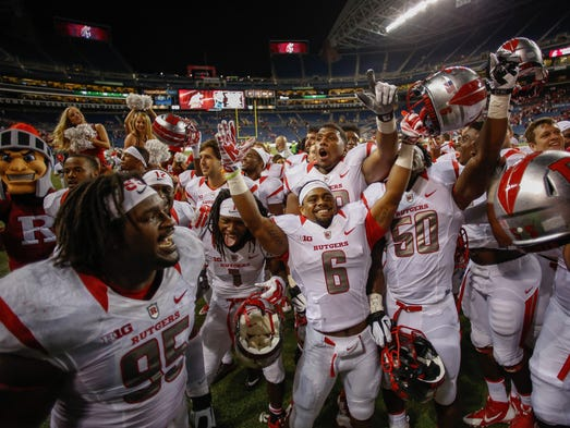 SEATTLE, WA - AUGUST 28:  Members of the Rutgers Scarlet Knights celebrate after defeating the Washington State Cougars 41-38 at CenturyLink Field on August 28, 2014 in Seattle, Washington.  (Photo by Otto Greule Jr/Getty Images)