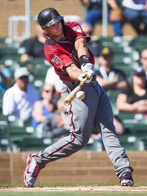 Arizona Diamondbacks first baseman Paul Goldschmidt hits during the first inning against the Colorado Rockies at Salt River Fields at Talking Stick, Friday, March 2, 2018.