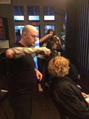 Even though he is the owner of G. Michael Salon, Greg Lee also has a full list of customers.