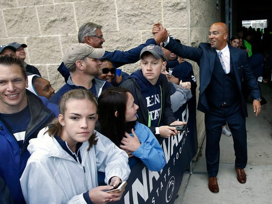 Penn State head coach James Franklin, right, shakes hands with a fan as the team arrives at the stadium to take on Akron in an NCAA college football game in State College, Pa., Saturday, Sept. 2, 2017. (AP Photo/Chris Knight)