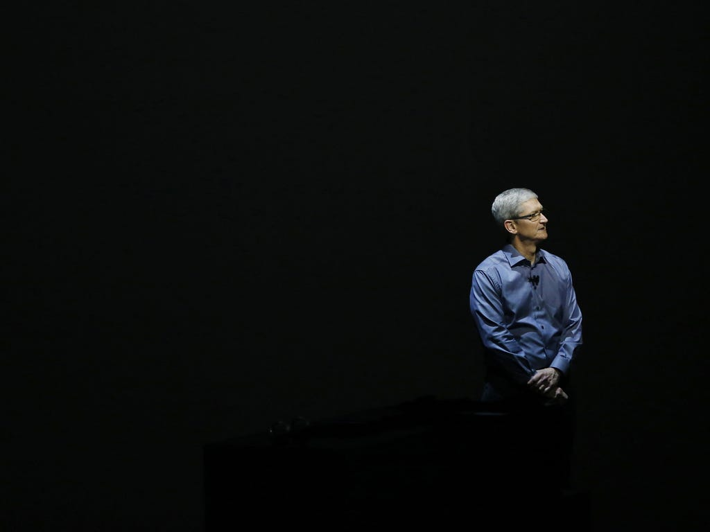 Apple CEO Tim Cook stands on stage during the Apple event at the Bill Graham Civic Auditorium in San Francisco.